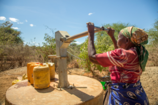 Woman in Kenya pumping water